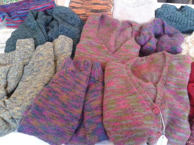 Hand Knitted clothes and sewing materials.
